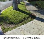 a corner concrete sidewalk... | Shutterstock . vector #1279571233