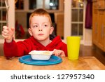 child eating an unhealthy... | Shutterstock . vector #127957340