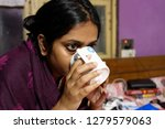 indian bengali woman is sipping ... | Shutterstock . vector #1279579063