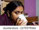 indian bengali woman is sipping ... | Shutterstock . vector #1279579066