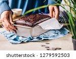 faceless shot of woman putting... | Shutterstock . vector #1279592503