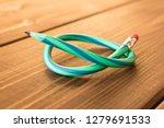 flexible pencil on wooden table ... | Shutterstock . vector #1279691533
