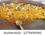 spanish paella served in all...   Shutterstock . vector #1279696960