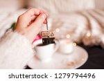 girl holding tea house for brew ... | Shutterstock . vector #1279794496