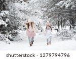 two kid girls having fun in... | Shutterstock . vector #1279794796