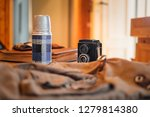 old  vintage photo camera and a ... | Shutterstock . vector #1279814380