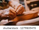 closeup view of mans hands... | Shutterstock . vector #1279835470