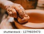 closeup view of mans hands... | Shutterstock . vector #1279835473