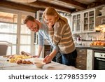 loving couple preparing pasta... | Shutterstock . vector #1279853599