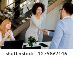 young businesspeople shaking... | Shutterstock . vector #1279862146