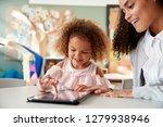 young mixed race schoolgirl... | Shutterstock . vector #1279938946