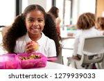 young black schoolgirl sitting... | Shutterstock . vector #1279939033