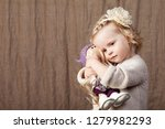 child girl playing with a dall. ... | Shutterstock . vector #1279982293