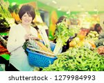 middle aged woman with basket... | Shutterstock . vector #1279984993