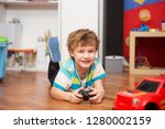 a boy playing with radio... | Shutterstock . vector #1280002159