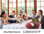 happy business people toasting... | Shutterstock . vector #1280035579