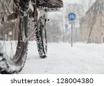 Cyclist In Winter With Bike...