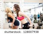 women working on their triceps... | Shutterstock . vector #128007938