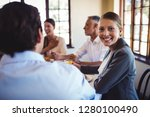 happy businesswoman looking at... | Shutterstock . vector #1280100490