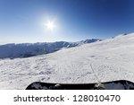 Snowboarder Resting On Ski...