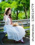 young girl in a smart long...   Shutterstock . vector #1280114779
