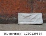 mattress left against old red... | Shutterstock . vector #1280139589