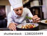 caucasian female chef... | Shutterstock . vector #1280205499