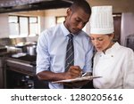 male manager and female chef... | Shutterstock . vector #1280205616