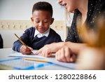 female primary school teacher...   Shutterstock . vector #1280228866