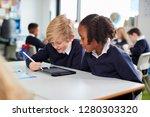 two primary school kids sitting ... | Shutterstock . vector #1280303320
