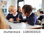 a girl and a boy using a tablet ... | Shutterstock . vector #1280303323