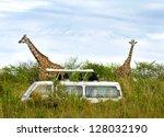 tourists on safari take... | Shutterstock . vector #128032190