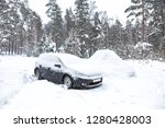 Black Dirty Car Under The Snow...