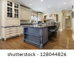 Stock photo upscale kitchen with a gray cabinet granite island 128044826