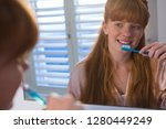 woman brushing her teeth in... | Shutterstock . vector #1280449249