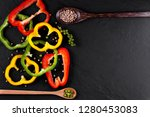 Three Sweet Peppers On A Wooden ...