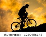 silhouette of a boy riding up a ... | Shutterstock . vector #1280456143