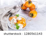 sliced persimmon with yogurt... | Shutterstock . vector #1280561143