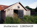 The Door Of An Old Gray Barn Is ...