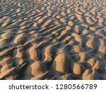 Ripples In The Sand On A Wind...