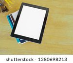 close uptablet on books in home. | Shutterstock . vector #1280698213