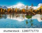 alpine lake   autumn   val di... | Shutterstock . vector #1280771773