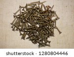screws on the fabric background   Shutterstock . vector #1280804446
