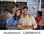 portrait of smiling couple... | Shutterstock . vector #1280864419