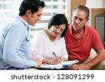 financial advisor talking to... | Shutterstock . vector #128091299
