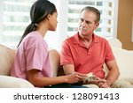 nurse discussing records with... | Shutterstock . vector #128091413