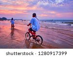 the cyclers enjoy the beach on... | Shutterstock . vector #1280917399