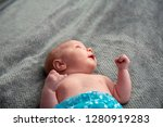 close up on newborn baby on the ... | Shutterstock . vector #1280919283
