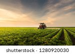 Tractor spraying pesticides at  ...