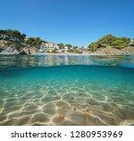 spain beach in llanca on the... | Shutterstock . vector #1280953969
